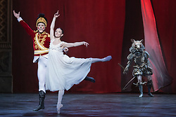"© Licensed to London News Pictures. 10/12/2014. London, England. L-R: Max Westwell as Nutcracker, Alina Cojocaru as Clara and James Streeter as Mouse King. Dress rehearsal for the ballet ""The Nutcracker"" at the London Coliseum. Set to music by Pyotr Ilyich Tchaikovsky, the traditional Christmas ballet is choreographed by Wayne Eagling based on a concept by Toer von Schayk and Wayne Eagling. The English National Ballet Philharmonic orchestra accompanies dancers from the English National Ballet and Students from the English National Ballet School. Children performers are from the Tring Park School for the Performing Arts. The ballet runs at the London Coliseum from 11 December 2014 to 4 January 2015.  With Alina Cojocaru as Clara, Max Westwell as Nutcracker, Alejandro Virellles as Nephew, James Streeter as Mouse King and Fabian Reimair as Drosselmeyer. Photo credit: Bettina Strenske/LNP"