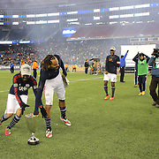Jermaine Jones, New England Revolution, celebrates his sides Eastern Conference Final win as Lee Nguyen prepares to run off with the trophy after the New England Revolution Vs New York Red Bulls, MLS Eastern Conference Final, second leg. Gillette Stadium, Foxborough, Massachusetts, USA. 29th November 2014. Photo Tim Clayton