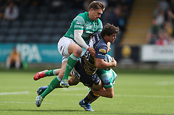 Worcester Warriors Francois Venter is tackled by Newcastle Falcons Toby Flood and Chris Harris during the Gallagher Premiership match at Sixways Stadium, Worcester.
