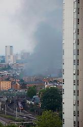 Anna Branthwaite, Camden, London<br /> 19/05/2014<br /> View of massive fire in Camden Town with a train arriving at Euston train station, running close by.<br /> Photo: Anna Branthwaite/LNP
