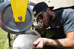Shaping metal on an English wheel at the Born Free chopper show. Silverado, CA. USA. Saturday June 23, 2018. Photography ©2018 Michael Lichter.