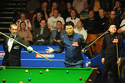 Liang Wenbo during his match against Ding Junhui on day eight of the Betfred Snooker World Championships at the Crucible Theatre, Sheffield.