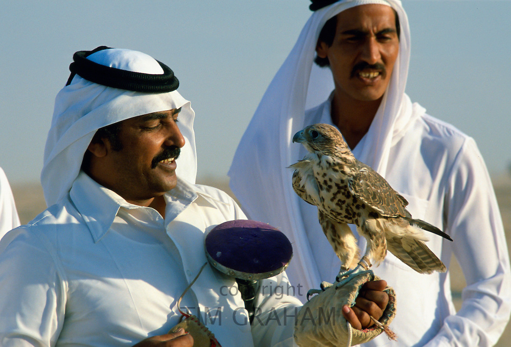 Falconers with a falcon in Qatar