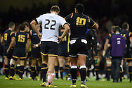 Dan Biggar of Wales (l) changes his shirt with Josh Matavesi of Fiji after the match. Rugby World Cup 2015 pool A match, Wales v Fiji at the Millennium Stadium in Cardiff, South Wales  on Thursday 1st October 2015.<br /> pic by  Andrew Orchard, Andrew Orchard sports photography.