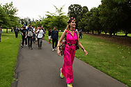 A well dressed protester marches with others along a path  during the Sack Daniel Andrews Protest in Fawkner Park. Parts of the community are looking to hold the Victorian Premier accountable for the failings of his government that led to more than 800 deaths during the Coronavirus crisis. Victoria has recorded 36 days Covid free as pressure mounts on the Premier Daniel Andrews to relax all remaining restrictions. (Photo by Michael Currie/Speed Media)