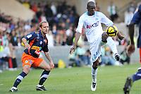 FOOTBALL - FRENCH CHAMPIONSHIP 2010/2011 - L1 - MONTPELLIER HSC v OLYMPIQUE MARSEILLE  - 17/04/2011 - PHOTO SYLVAIN THOMAS / DPPI - ROD FANNI (OM) / GEOFFREY DERNIS (MON)