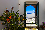 Open door with a view to the sea