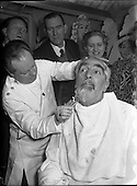 1955 Mr Noel Purcell having his beard removed for Pantomime