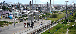 South Africa -Cape Town - 28 September 2020- Children from Enkanini swinging on the Metrorail power lines that have been vandalised.This looks dangerous as no one is sure if the is no power on the poles and there has been children that were shocked to death in the area..Picture:Phando Jikelo/African News Agency(ANA)