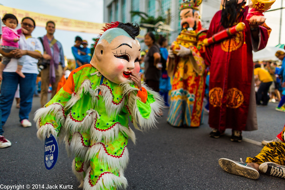 24 SEPTEMBER 2014 - BANGKOK, THAILAND: A boy dessed as a Taoist God marches in the Vegetarian Festival in Bangkok. The Vegetarian Festival is celebrated throughout Thailand. It is the Thai version of the The Nine Emperor Gods Festival, a nine-day Taoist celebration beginning on the eve of 9th lunar month of the Chinese calendar. During a period of nine days, those who are participating in the festival dress all in white and abstain from eating meat, poultry, seafood, and dairy products. Vendors and proprietors of restaurants indicate that vegetarian food is for sale by putting a yellow flag out with Thai characters for meatless written on it in red.    PHOTO BY JACK KURTZ