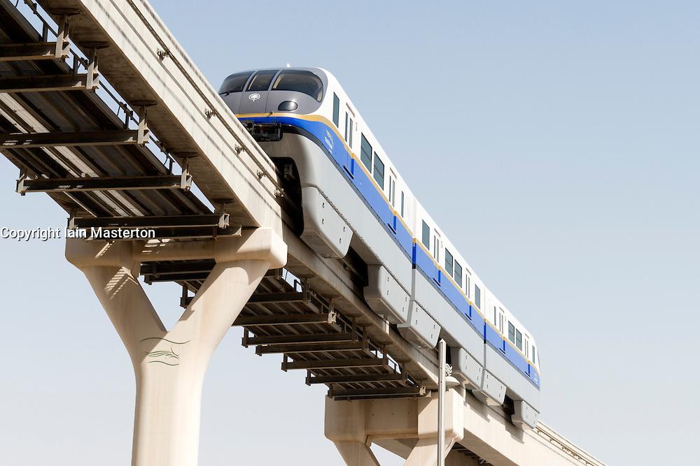 Overhead monorail railway transporting passengers to The Atlantis Hotel on The Palm Jumeirah island in Dubai United Arab Emirates