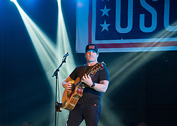 December 21, 2017 - Sevilla, Spain - Country music artist Jerrod Niemann performs during Chairmans USO Holiday Tour at Moon Air Base Dec. 21, 2017. Marine Corps Gen. Joe Dunford, chairman of the Joint Chiefs of Staff, and Army Command Sgt. Maj. John W. Troxell, senior enlisted advisor to the chairman, along with USO entertainers, visited service members who are deployed during the holidays at various locations across Europe and the Middle East. .(Credit Image: