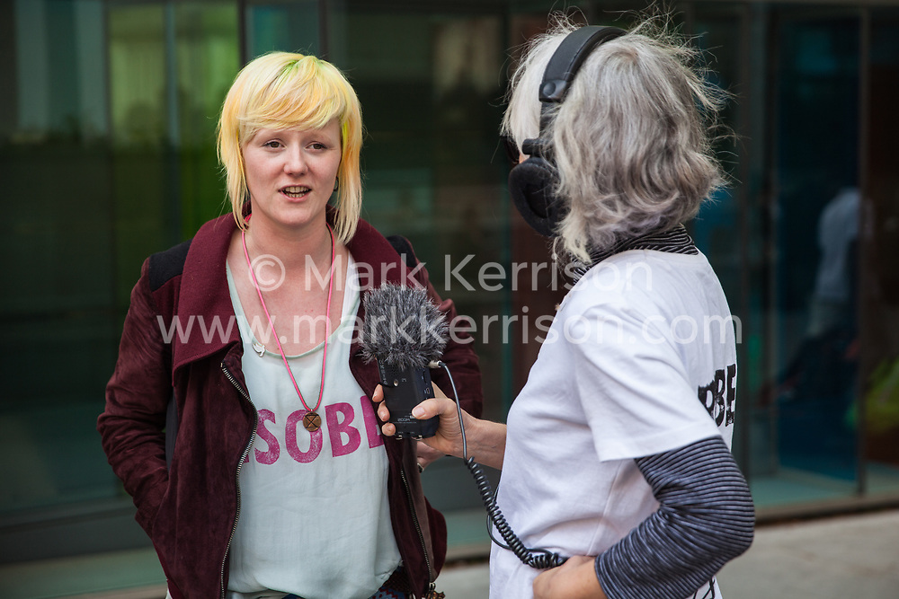 London, UK. 30th April 2019. Climate change activist from Extinction Rebellion Clare Farrell is interviewed outside the Home Office after attending a meeting hosted by the Secretary of State for the Environment Michael Gove.