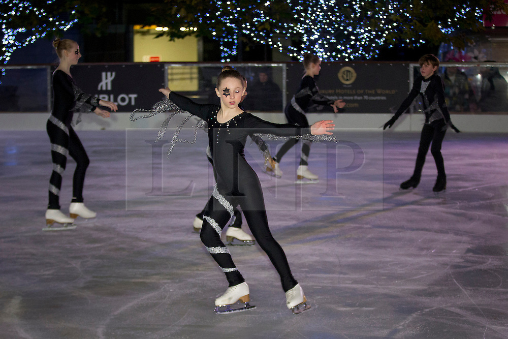 © Licensed to London News Pictures. 07/11/2012. London, UK. Young skaters perform at the press launch of the Canary Wharf Ice Rink in London today (07/11/12).  The temporary ice rink, which is London's longest running, is open to the public from the 3rd of November 2012 to the 13th of January 2013. Photo credit: Matt Cetti-Roberts/LNP