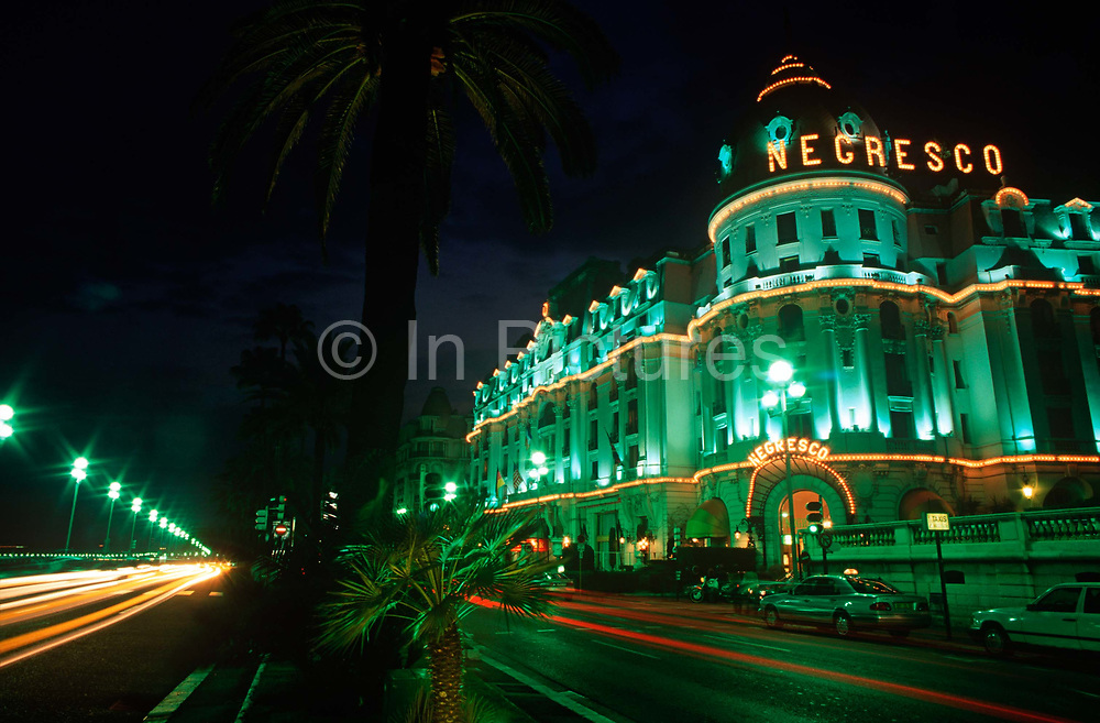 Exterior of the Cote dAzurs Hotel Negresco on the Promenade de Anglais, on 10th May 1996, in Nice, France. The Hotel Negresco on the Promenade des Anglais on the Baie des Anges in Nice, France was named for Henri Negresco 1868-1920 who had the palatial hotel constructed in 1912. Noted for its doormen dressed in the manner of the staff in 18th-century elite bourgeois households, complete with red-plumed postilion hats, the hotel also offers renowned gourmet dining at Le Chantecler. In 2003 the Hotel Negresco was listed by the government of France as a National Historic Building.
