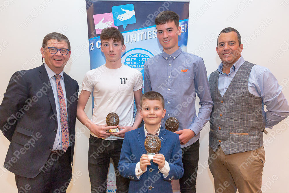 Clare Community Games Chairman John Wall and Louis Faye of St Francis Credit Union present trophies to Ian McNamara, winner in badminton, Mark Hanrahan, winner in Marathon and Oisin Collins, winner in U10 draughts at the Community Games All Star Awards at Treacys West County on Friday Night