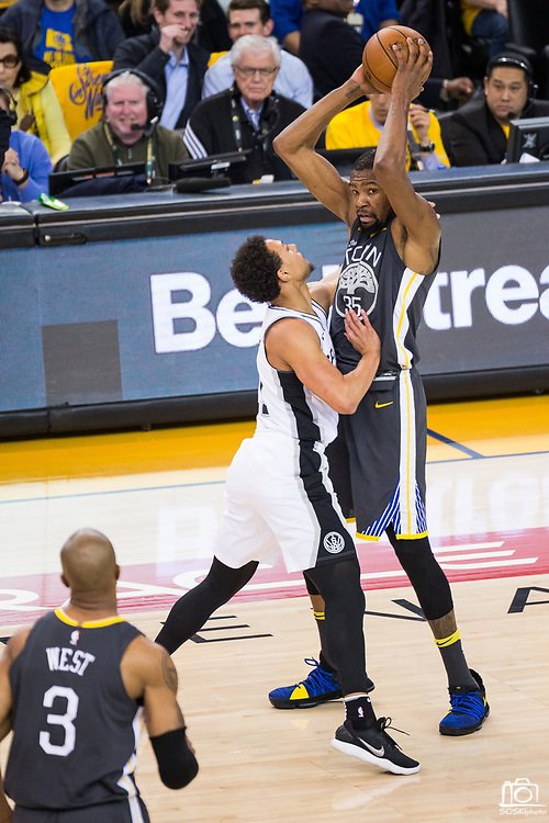 Golden State Warriors forward Kevin Durant (35) holds the ball against the San Antonio Spurs during Game 2 of the Western Conference Quarterfinals at Oracle Arena in Oakland, Calif., on April 16, 2018. (Stan Olszewski/Special to S.F. Examiner)