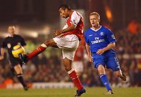 Fotball<br /> Premier League England 2004/2005<br /> Foto: BPI/Digitalsport<br /> NORWAY ONLY<br /> <br /> Arsenal v Chelsea<br /> FA Barclays Premiership, Highbury 12/12/04<br /> <br /> Arsenal's Ashley Cole clears from Chelsea's Damien Duff