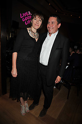 JOOLS HOLLAND and his wife CHRISTABEL at fundraising dinner and auction in aid of Liver Good Life a charity for people with Hepatitis held at Christies, King Street, London on 16th September 2009.