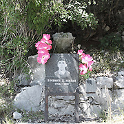 """a trombstone of a young man dead in a car accident.There are several arguments about the derivation of the name  """"Montenegro"""", one of these relates to dark and deep forests  that once covered the Dinaric Alps, as it was possible to see them from the sea. <br /> Mostly mountainous with 672180 habitants on an area of 13812 Km², with a population density of  48 habitants/Km². <br /> It borders with Bosnia, Serbia, Croatia, Kosovo and Albania but  Montenegro has always been alien to the bloody political events that characterized Eastern Europe in recent decades. <br /> From 3 June 2006, breaking away from Serbia, Montenegro became an independent state. <br /> In the balance between economy devoted to sheep farming and a shy tourist, mostly coming from Bosnia and Herzegovina, Montenegro looks to Europe with a largely unspoiled natural beauty. <br /> Several cities in Montenegro, as well as the park Durmitor, considered World Heritage by UNESCO but not yet officially because Montenegro has yet to ratify the World Heritage Convention of UNESCO."""