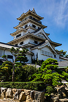 """Imabari Castle - Though it is officially classified as a rinkakushiki, a flatland castle, but because its wide moat is fed by the nearby sea, Imabari Castle is also one of the """"three great water castles"""".  Imabari Castle was built in 1602 by Todo Takatora, widely considered to be the greatest Japanese castle builder. Of the great castles he built:  Edo in Tokyo and Nijo Castle in Kyoto, - were built for others, Imabari he built for   himself.  One of Todo's innovations  here was building wide moats for extra protection from firearms. The moat at Imabari Castle could also have the water level raised or lowered by a series of sluice gates."""