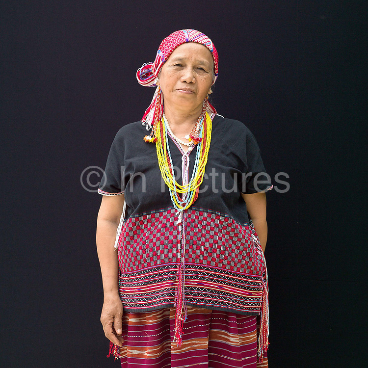 Der Her 65 an ethnic Karen Sgaw woman from the Chiang  Dao mountains at Baan Tong Luang, Eco-Agricultural Hill Tribes Village on 7th June 2016 in Chiang Mai province, Thailand. The fabricated village is home to 8 different hill tribes who make a living from selling their handicrafts and having their photos taken by tourists  at Baan Tong Luang, Eco-Agricultural Hill Tribes Village on 7th June 2016 in Chiang Mai province, Thailand. The fabricated village is home to 8 different hill tribes who make a living from selling their handicrafts and having their photos taken by tourists