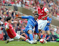 Photo: Ed Godden/Sportsbeat Images.<br /> Arsenal v Chelsea. The Barclays Premiership. 06/05/2007.<br /> Arsenal's Cesc Fabregas (L), challenges John Obi Mikel for the ball.