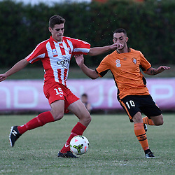 BRISBANE, AUSTRALIA - FEBRUARY 25: Tyler Wagstaffe of Olympic FC controls the ball under pressure from Nicholas Panetta during the NPL Queensland Senior Men's Round 1 match between Olympic FC and Brisbane Roar Youth at Goodwin Park on February 25, 2017 in Brisbane, Australia. (Photo by Patrick Kearney/Olympic FC)