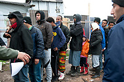 France. Refugees. Calais. So-called Jungle camp . Refugees queue for a distribution of blankets.
