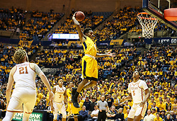 Jan 20, 2018; Morgantown, WV, USA; West Virginia Mountaineers guard Daxter Miles Jr. (4) grabs a rebound during the second half against the Texas Longhorns at WVU Coliseum. Mandatory Credit: Ben Queen-USA TODAY Sports