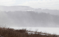 Salisbury Mills, New York -  Fog burns off in a field on a warm winter day on Jan. 2, 2010.