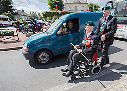 © Licensed to London News Pictures. 05/06/2014.  Len Bloomfield (93) , a DDay Veteran and former member of the Royal Marines is taken down to Pegasus Bridge this afternoon as part of the 70th Anniversary of the D Day landings in Normandy.  Photo credit : Alison Baskerville/LNP