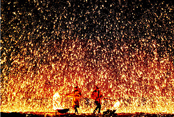May 3, 2019 - Zhangjiakou, China - Performers throw molten iron to create fireworks during the ''Dashuhua'' folk festival in Xuanhua District of Zhangjiakou, north China's Hebei Province. People across China take advantage of the four-day Labor Day national holiday to get relaxed in recreational activities. (Credit Image: © Xinhua via ZUMA Wire)