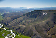 """Scenic aerial picture of Tenderfoot """"W"""" Mountain, Tomichi Creek and its valley, looking east from Gunnison."""