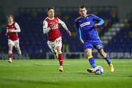 AFC Wimbledon attacker Adam Roscrow (10) passing the ball during the EFL Trophy match between AFC Wimbledon and U21 Arsenal at Plough Lane, London, United Kingdom on 8 December 2020.