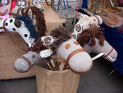 Old fashioned traditional hobby horses for sale in open air market in Prenzlauer Berg in Berlin Germany 2009