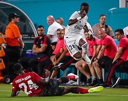 July 31, 2018 - Miami Gardens, Florida, USA - Manchester United F.C. defender Timothy Fosu-Mensah (24) slide tackles to steal the ball from Real Madrid C.F. forward Vinicius Junior (28) during an International Champions Cup match between Real Madrid C.F. and Manchester United F.C. at the Hard Rock Stadium in Miami Gardens, Florida. Manchester United F.C. won the game 2-1. (Credit Image: © Mario Houben via ZUMA Wire)