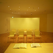 Empty chairs and open Bibles, all bathed in yellow artificial light make this airport chapel in Frankfurt am Main, Germany a European modernist haven from the chaos of global air travel; an escape from delays, terrorism and overall fears of flying. Predominately Christian with small corners for Muslim believers, the new modernism at Frankfurt/Main reflects a strong European tradition of functional design – far removed from the drab, dourness of many similar American facilities. Picture from the 'Plane Pictures' project, a celebration of aviation aesthetics and flying culture, 100 years after the Wright brothers first 12 seconds/120 feet powered flight at Kitty Hawk,1903.