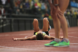 Olympic Trials Eugene 2012: women.s 10,000 meter final, Amy Hastings lays on track after winning, making USA Olympic team