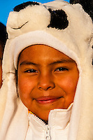 Navajo girl wearing spirit hood, Red Rock State Park, Gallup, New Mexico USA.