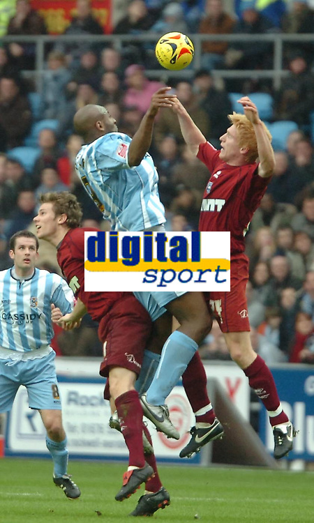 Photo: Ed Godden.<br />Coventry City v Brighton & Hove Albion. Coca Cola Championship. 04/02/2006. <br />Coventry's Dele Adebola, finds himself sandwiched in between two coventry players.