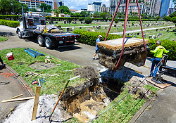 August 22, 2017 - West Palm Beach, Florida, U.S. - With the Confederate Monument in Woodlawn Cemetery already on a flatbed truck, workers remove the base Tuesday afternoon.(Credit Image: © Lannis Waters/The Palm Beach Post via ZUMA Wire)