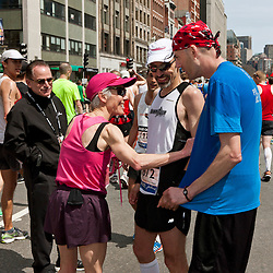 2013 Boston Marathon: Joan Benoit Samuelson signs autographs in finish chute after race