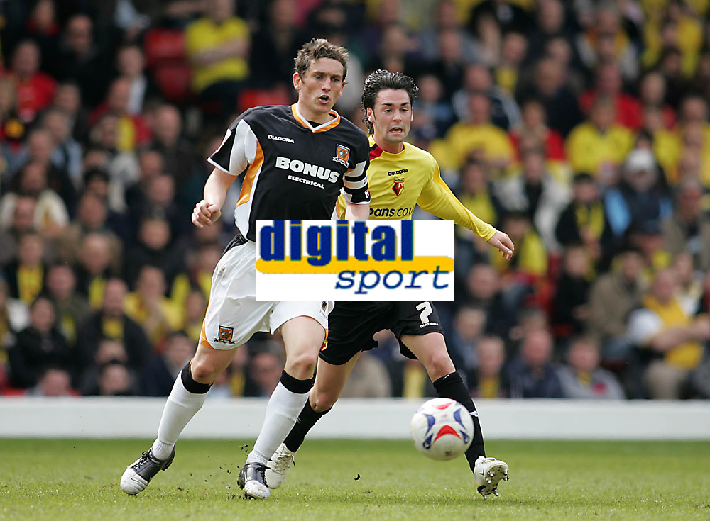 Photo: Lee Earle.<br /> Watford v Hull. Coca Cola Championship. 30/04/2006. Hull's Keith Andrews (L) battles with Chris Eagles.