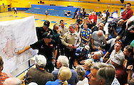 Residents evacuated from the Yarnell Hill fire listen to Incident Commander Clay Templin (L) discuss the burned area at a community meeting in Prescott, Arizona July 2, 2013.   An elite squad of 19 Arizona firemen was  killed in the worst U.S. wildland firefighting tragedy in 80 years apparently outflanked and engulfed by wind-whipped flames in seconds, before some could scramble into cocoon-like personal shelters on June 30, 2013.  REUTERS/Rick Wilking (UNITED STATES)
