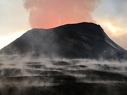 June 16, 2018 - Hawaii, U.S. - Fissure 8 produces a lava fountain that pulses to heights of 55 to 60 m (185 to 200 ft). Spattering has built a cinder cone that partially encircles fissure 8, now 51 m (170 ft) tall at its highest point. The steam in the foreground is the result of heavy morning rain falling on warm (not hot) tephra (lava fragments). (Credit Image: © USGS/ZUMA Wire/ZUMAPRESS.com)