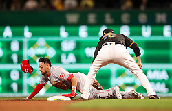 Jun 15, 2018; Pittsburgh, PA, USA; Cincinnati Reds center fielder Billy Hamilton (6) steals a base during the ninth inning against the Pittsburgh Pirates at PNC Park. Mandatory Credit: Ben Queen-USA TODAY Sports