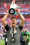 Rotherham United's Alex Revell celebrates lifting the League One Playoff Trophy . Skybet football league one play off final match , Leyton Orient  v Rotherham Utd at Wembley Stadium in  London on Sunday 25th May 2014.<br /> pic by John Patrick Fletcher, Andrew Orchard sports photography.