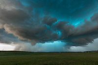 As this supercell continued south of Sundance, it took on a very blue coloring. At the time it was dropping baseball-sized hail, which accumulated on the highway.