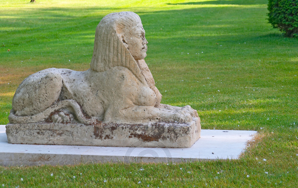 The park garden at Chateau Mouton Rothschild with a stone sphynx sphinx sfinx Pauillac Medoc Bordeaux Gironde Aquitaine France